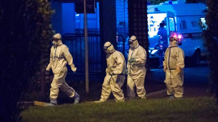 Medical workers wearing protective gear walk after an evacuation at Spasokukotskogo Hospital in Moscow, Russia,