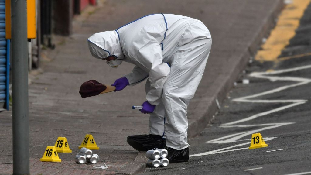 A forensic officer at the scene in the village of Pen Y Graig