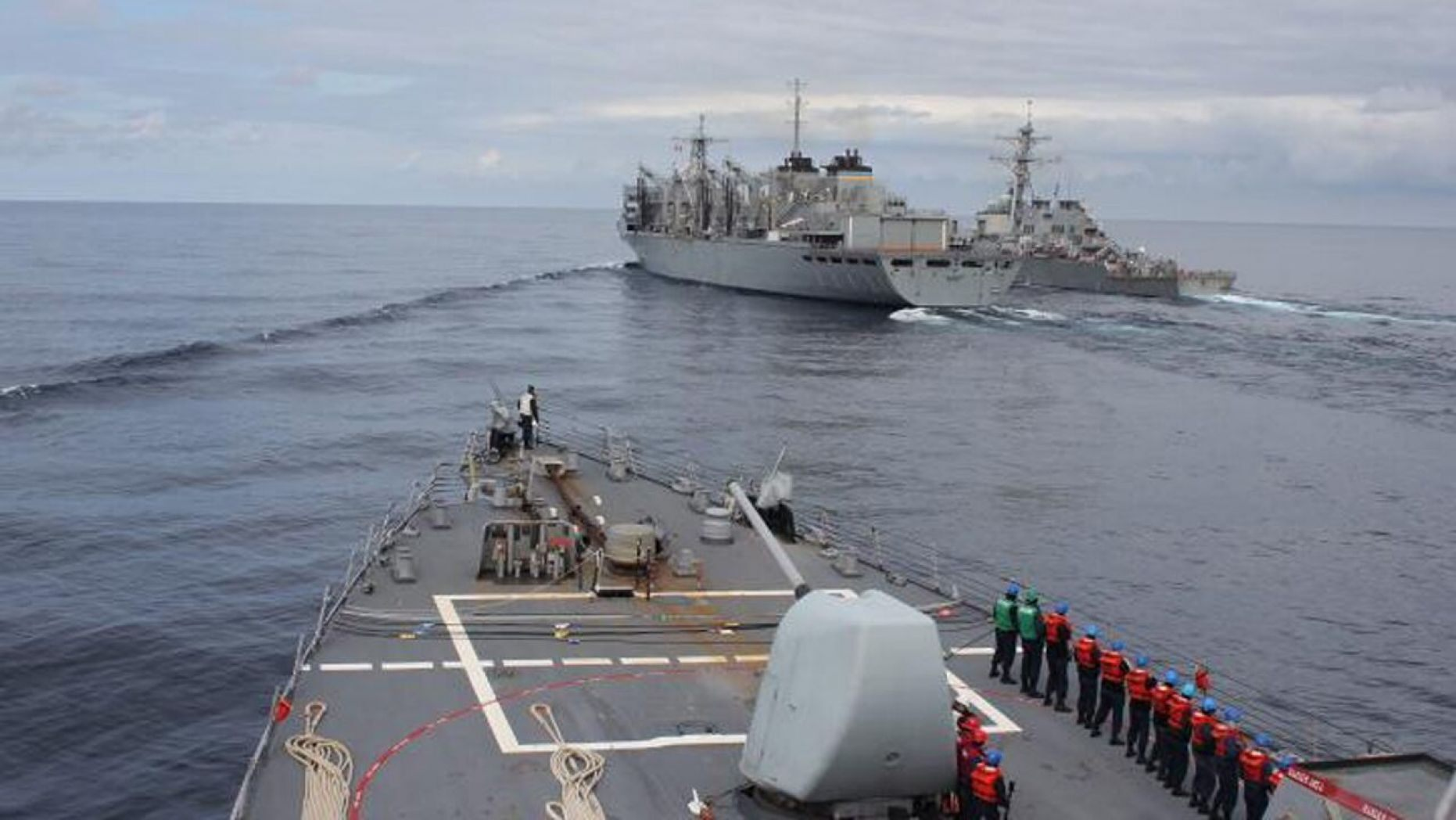 The Arleigh Burke-class guided-missile destroyer USS Donald Cook makes her approach alongside USNS SUPPLY and USS Porter for a connected replenishment to receive fuel and stores on April 28.