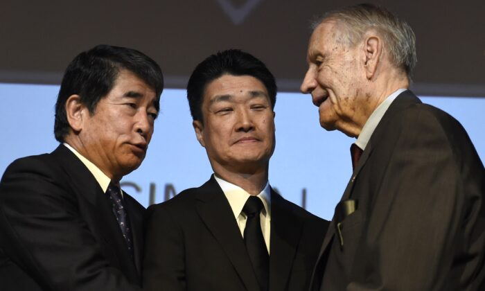 Yukio Okamoto (L) shakes hands with American World War II prisoner of war James Murphy (R) at Simon Wiesenthal Center's Museum of Tolerance in Los Angeles on July 19, 2015.