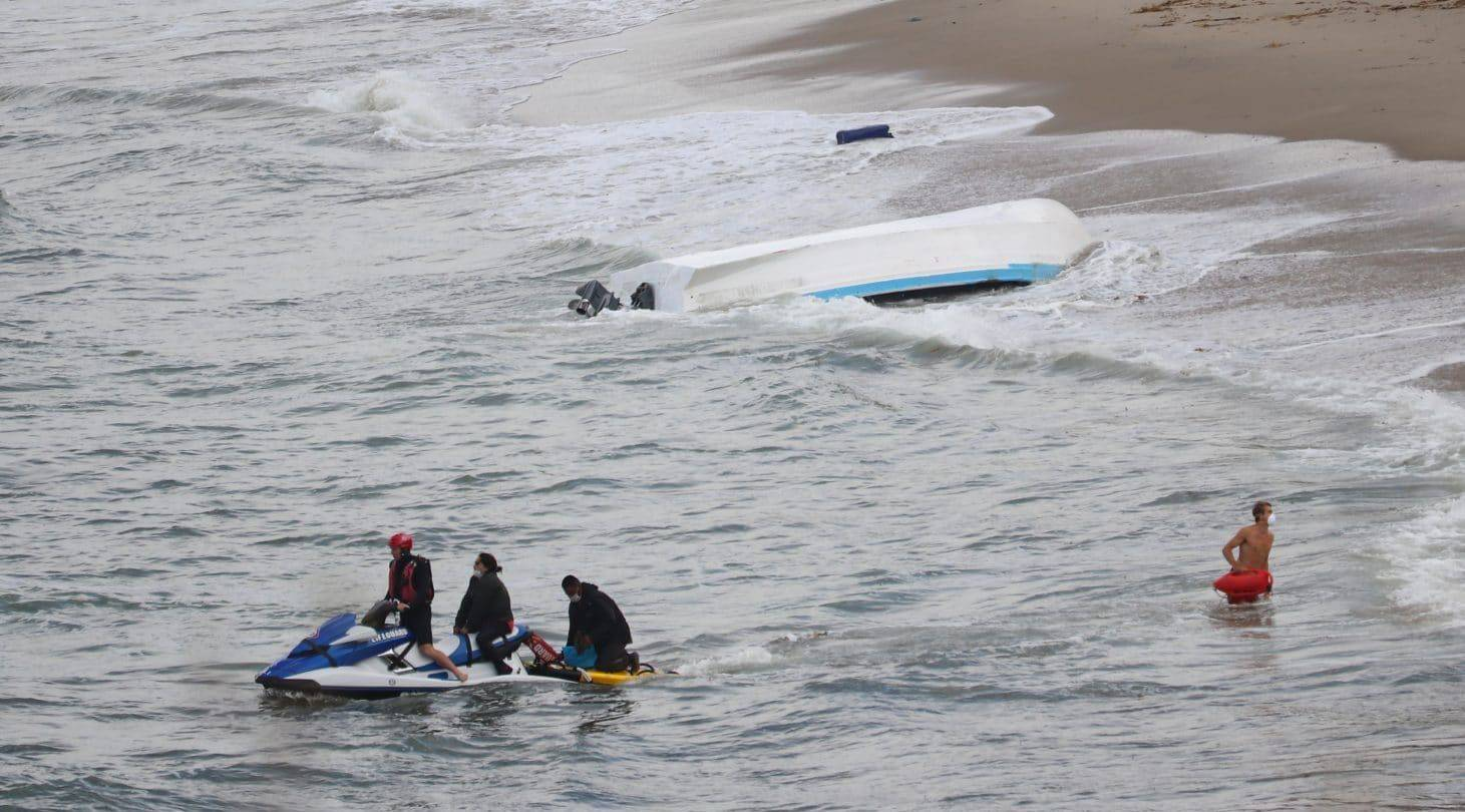 A panga that officials said was being used to smuggle people into the country capsized in Sunset Cliffs early Monday;