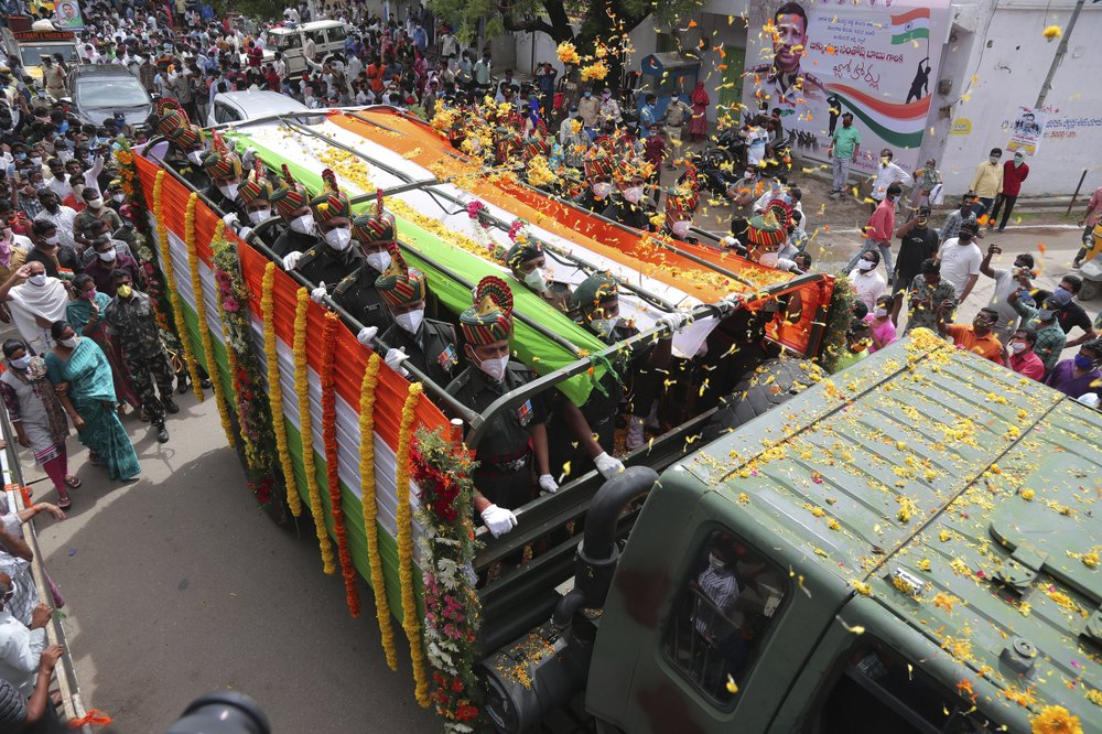A truck carrying the coffin of Indian army officer Colonel B. Santosh Babu arrives in Suryapet,