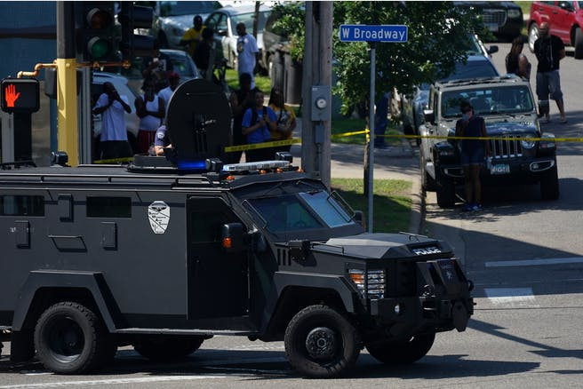 Gallery: Police secured the scene at the intersection of West Broadway Avenue and Irving Avenue North in north Minneapolis as they used a loudspeaker to negotiate with a suspect they believed was hold up in the building after a shooting earlier in the morning.