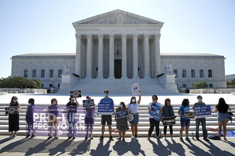 Anti-abortion protesters wait outside the Supreme Court for a decision, Monday, June 29, 2020,