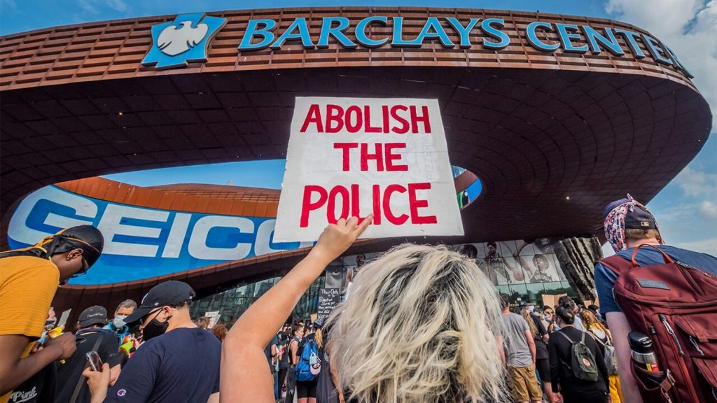 BROOKLYN, NEW YORK, UNITED STATES - 2020/05/29: A participant holding a sign reading Abolish The Police at the protest outside the Barclays Center.