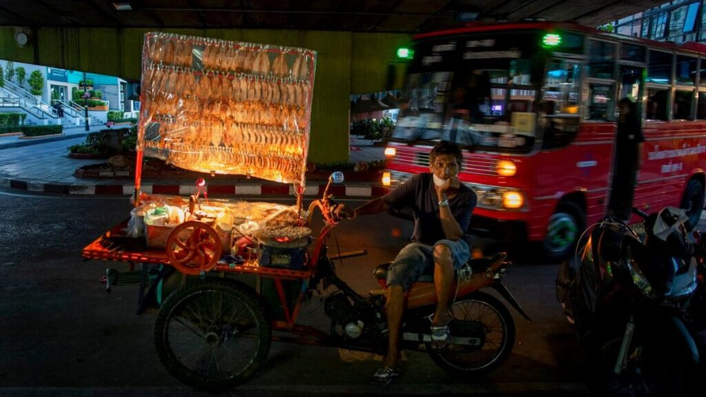A mobile food vender looks for customers in Bangkok, Thailand, Tuesday, June 9, 2020.  (AP)