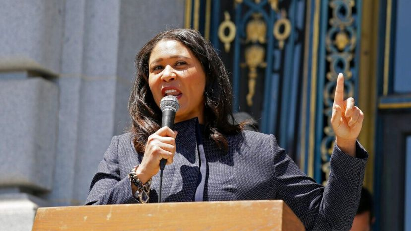 FILE: San Francisco Mayor London Breed speaks to a group protesting police racism outside City Hall in San Francisco.