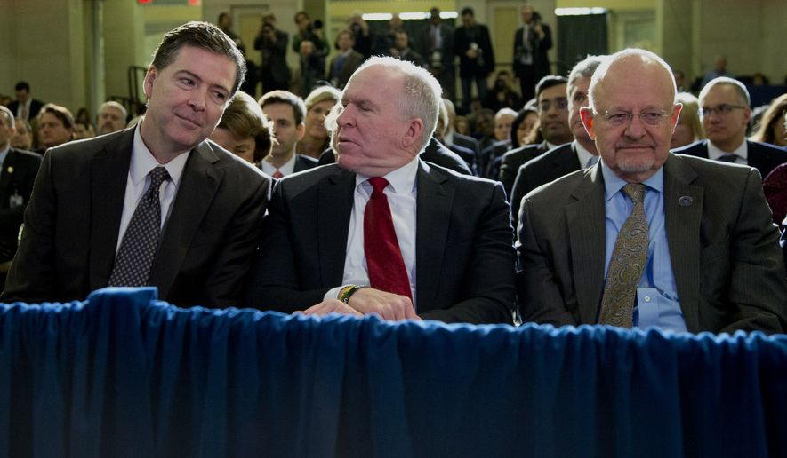 From left, FBI Director James Comey, CIA Director John Brennan, and Director of National Intelligence James Clapper sit together in the front row before President Barack Obama spoke about National Security Agency (NSA) surveillance in this Friday, Jan. 17, 2014, file photo at the Justice Department in Washington.