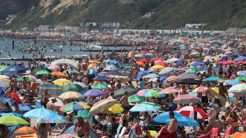 Crowds gather on the beach in Bournemouth as the U.K. experience a heat wave, in Bournemouth, England, on Thursday.
