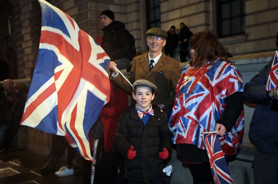 Brexit supporters celebrate leaving the European Union as they congregate in Parliament Square Dec. 31. The Home Office said Friday that more than 3.3 million European Union residents can remain in Britain after Brexit.