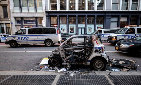 A destroyed NYPD police car is seen after a night of protest in Lower Manhattan in New York City on June 1, 2020.