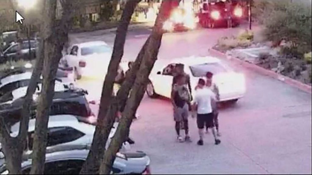 The off-duty officer, seen wearing shorts and a t-shirt, identified himself as a Dallas police officer before telling the group to leave. (Dallas Police Department)