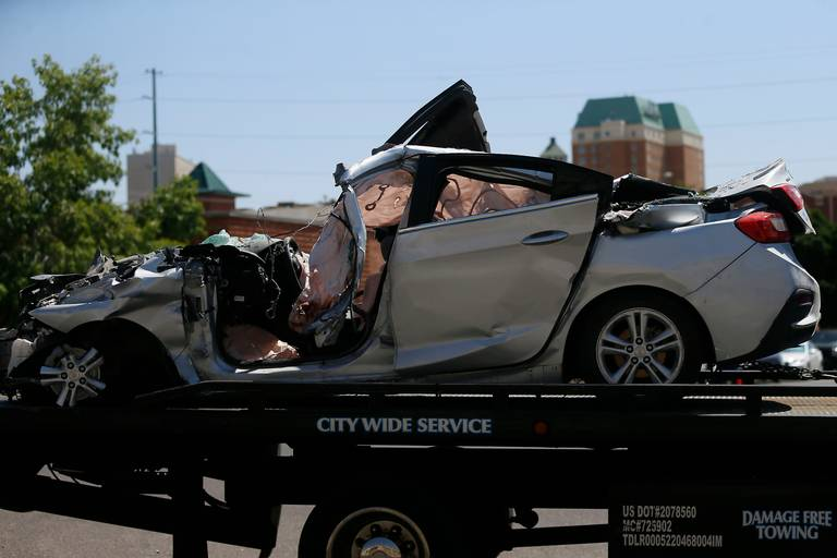 A damaged silver four-door vehicle is transported after being involved in a crash involving 10 people Thursday, June 25, 2020, in El Paso, Texas.