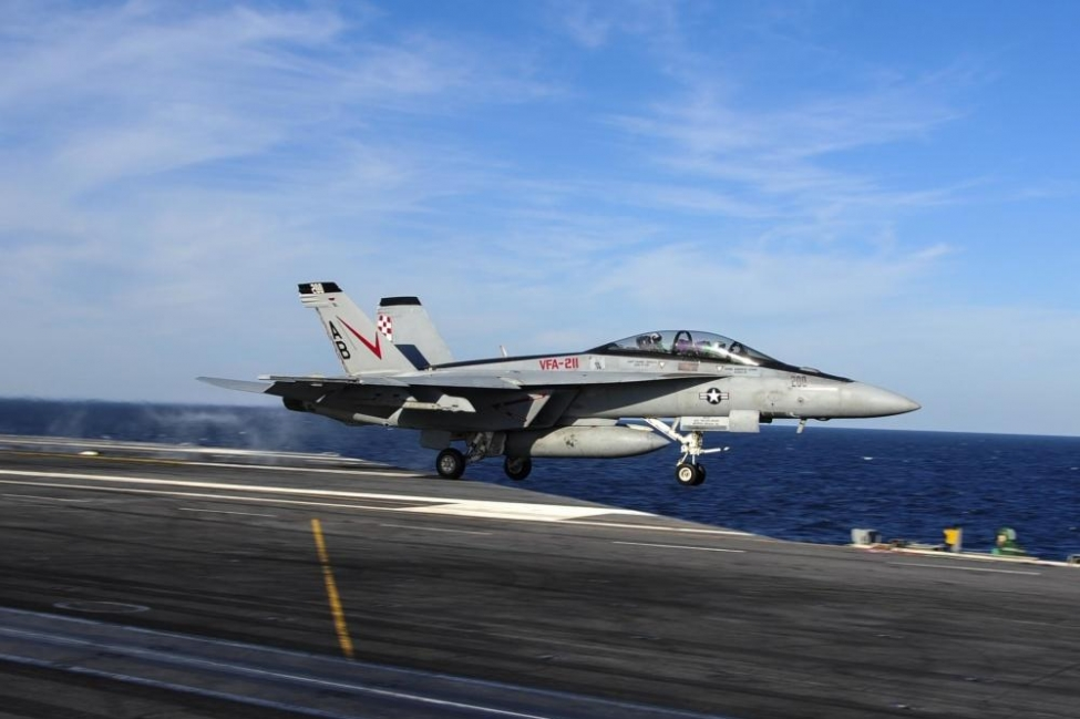 An F/A-18F Super Hornet assigned to the Checkmates of Strike Fighter Attack Squadron (VFA) 211 is launched off the flight deck of the aircraft carrier USS Theodore Roosevelt in 2014.