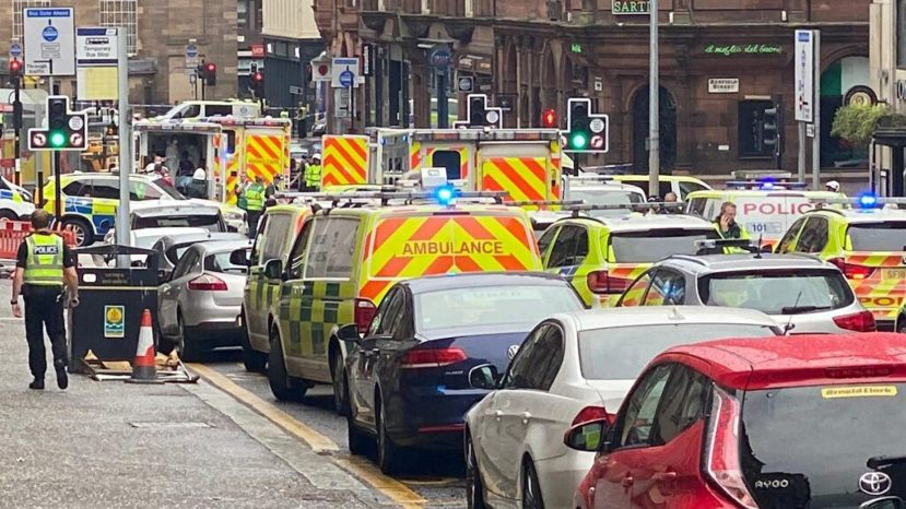 Emergency responders are seen near a scene of reported stabbings, in Glasgow, Scotland, Britain June 26, 2020,