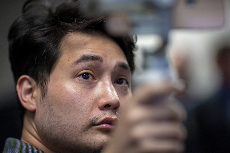 In this Sept. 12, 2019 photo, Andy Ngo, a conservative writer attends a press conference in Portland, Ore.