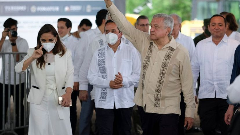Mexican President Andres Manuel Lopez Obrador waves to supporters in Lazaro Cardenas, Quintana Roo state, Mexico, Monday, June 1, 2020.