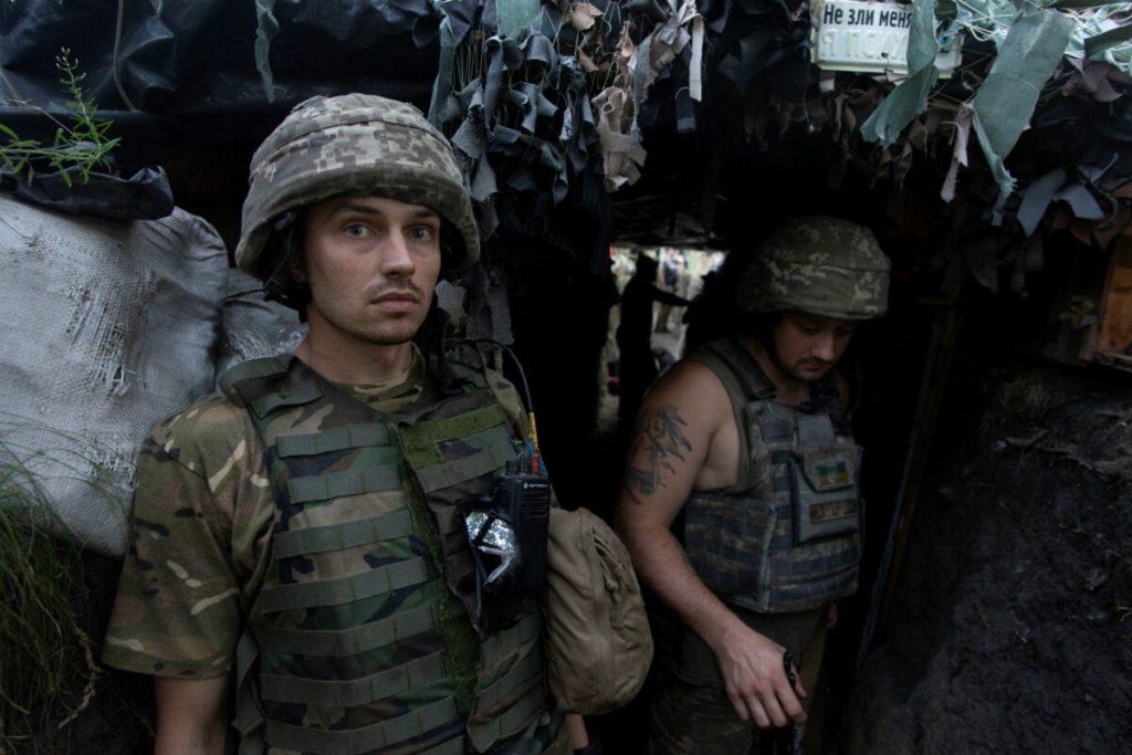 Ukrainian servicemen are seen at a position on the front line near the town of Novotoshkivske in Luhansk region, Ukraine July 26, 2020.