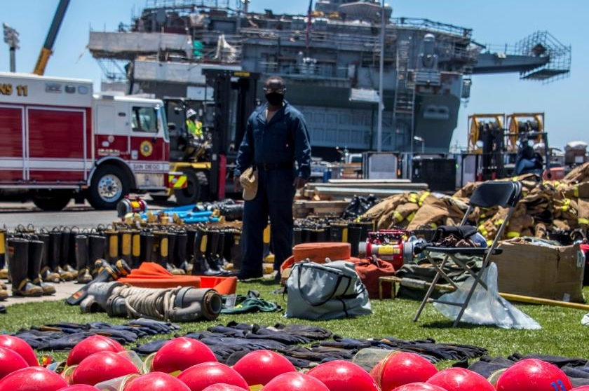 Fire crews on the USS Bonhomme Richard were still fighting Thursday to contain a blaze that broke out on Sunday.