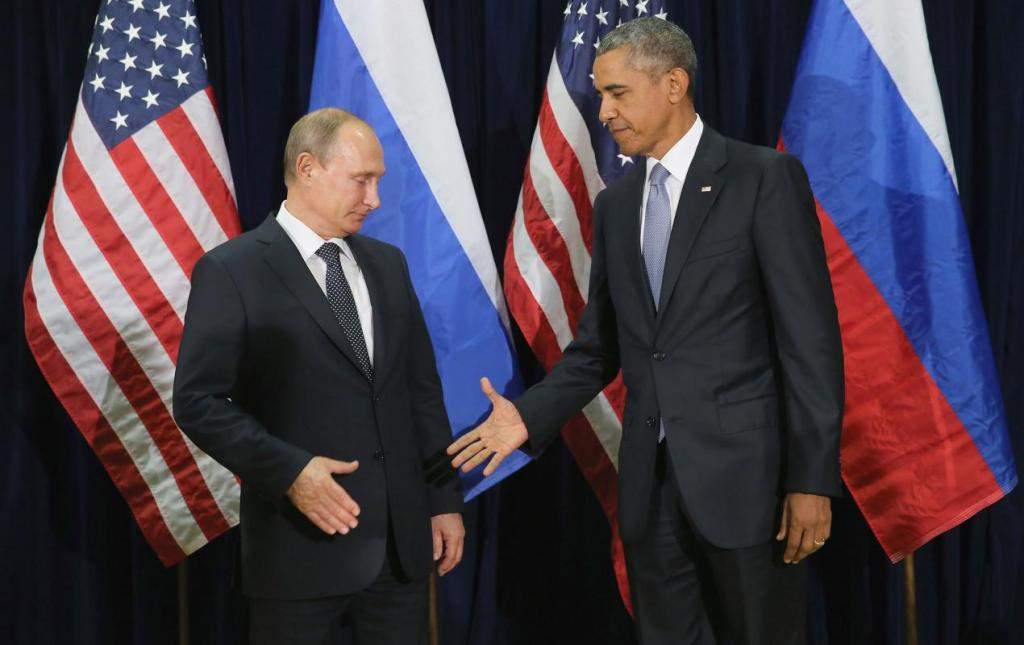 President Obama and Russian leader Vladimir Putin shake hands in 2015.