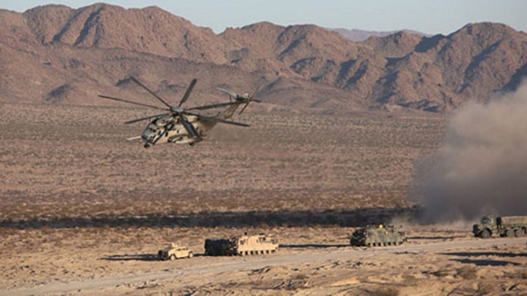 A CH-53E Sea Stallion Helicopter flies in for a simulated medical evacuation ,