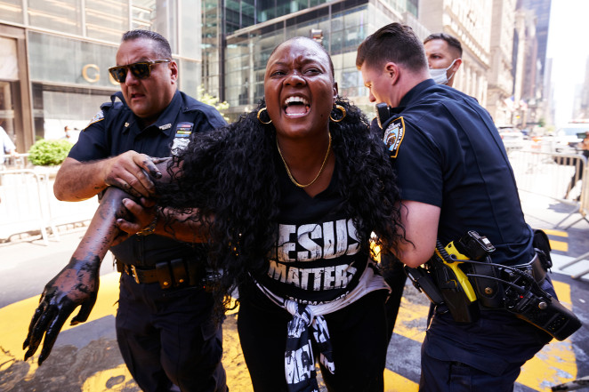 Bevelyn Beatty is detained by NYPD cops after defacing a Black Lives Matter mural at Trump Tower.