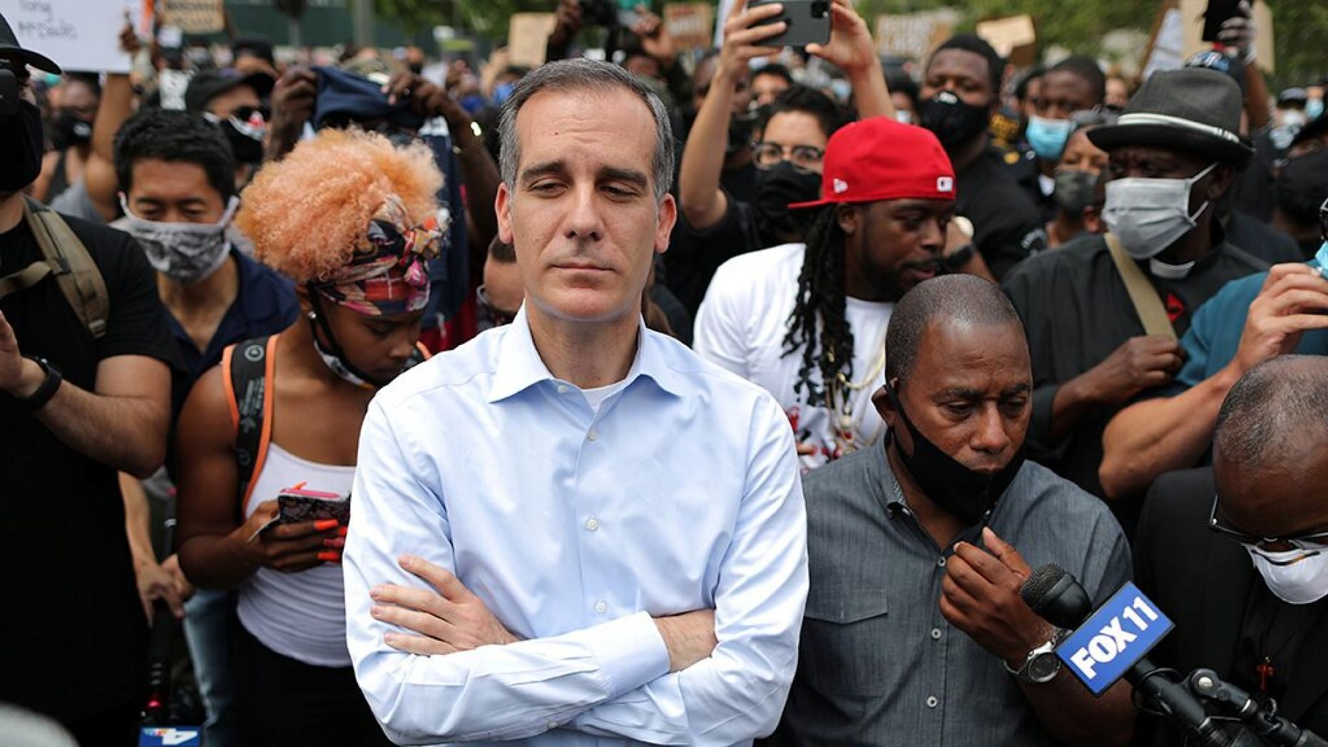 A Los Angeles police officer who was once assigned to Mayor Eric Garcetti's security detail claims in a lawsuit that an aide sexually harassed him for years in the presence of the mayor.