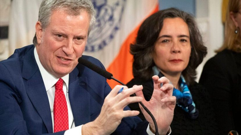 Dr. Oxiris Barbot, seen with Mayor Bill de Blasio earlier this year, abruptly resigned as New York City health commissioner.