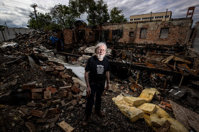 Don Blyly stood on the ruins of Uncle Hugo's Science Fiction & Uncle Edgar's Mystery Bookstores on S. Chicago Avenue in Minneapolis on Wednesday.