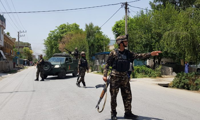 Afghan security forces arrive at an area where explosions and gunshots were heard, in Jalalabad city, Afghanistan, on July 28, 2018.
