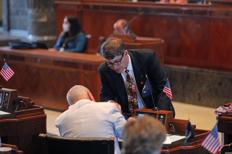 State Sen. Kirk Talbot, R-River Ridge, talks with Sen. Jay Morris, R-Monroes, as the Senate convenes in the Senate chamber in Baton Rouge, La., Monday, May 4, 2020.