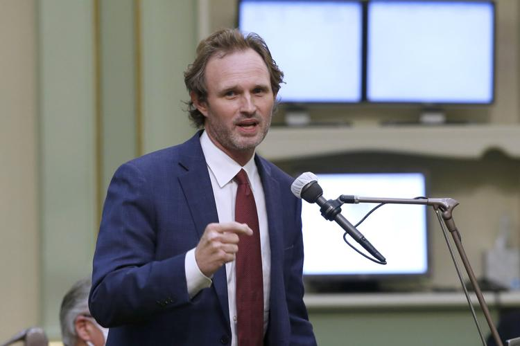 In this photo taken Monday, June 10, 2020, Assemblyman James Gallagher, R-Yuba City, left, speaks at the Capitol in Sacramento, Calif.