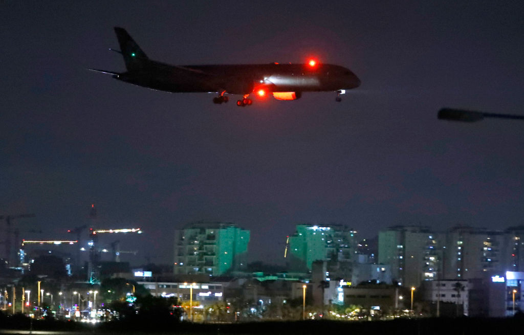 "Pictured: A cargo plane operated by Etihad Airways, carrying medical aid from the UAE for Palestinians, prepares to land at Israel's Ben Gurion Airport on June 9, 2020. The Palestinian Authority rejected the shipment because the Palestinians ""refuse to be a bridge [for Arab countries] seeking to have normalized ties with Israel."""