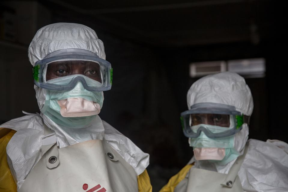 GOMA, NORTH KIVU, DEMOCRATIC REPUBLIC OF CONGO - Medical staff dressed in protective gear