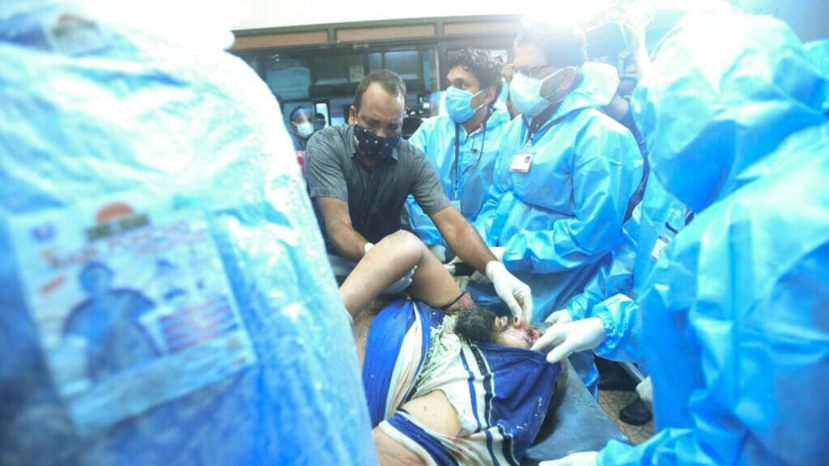 One of the injured after an Air India Express flight skidded off a runway while landing at the Kozhikode airport is brought for treatment to the Medical College Hospital in Kozhikode, Kerala state, India.