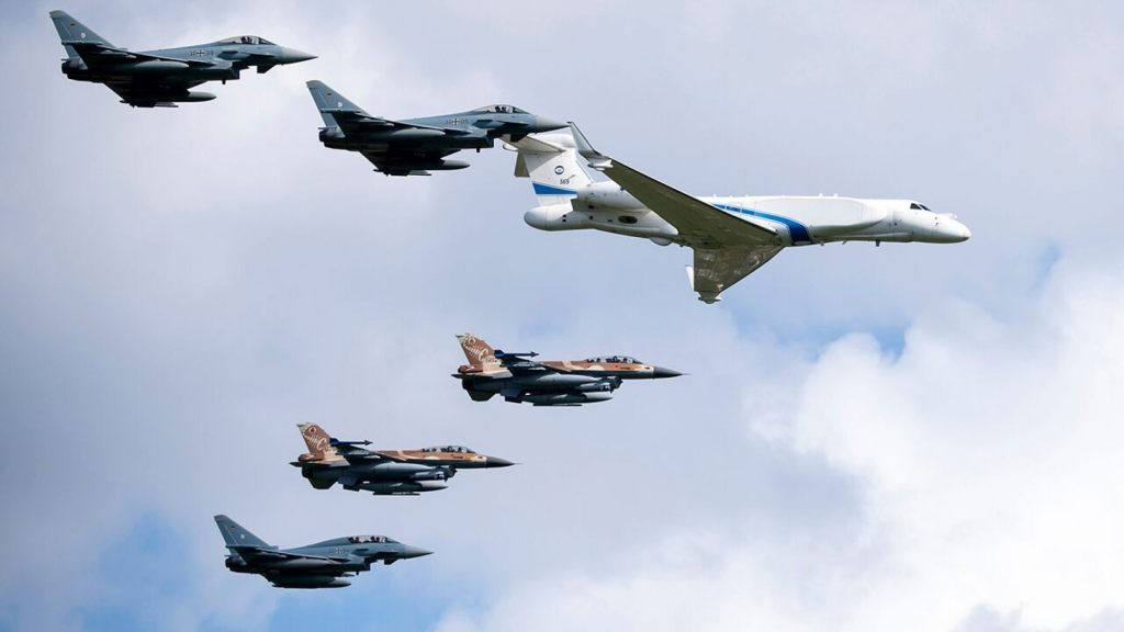 German air force Bundeswehr Eurofighters and an Israeli Air Force jets fly in formation over the Fuerstenfeldbruck airbase in commemoration of the 1972 Olympic Games assassination attempt in Fuerstenfeldbruck, Germany, Tuesday, Aug. 18, 2020.