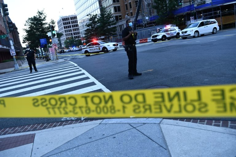 Police activity at the entrance to Pennsylvania Avenue near the White House shortly after Secret Service guards shot a person who was apparently armed,