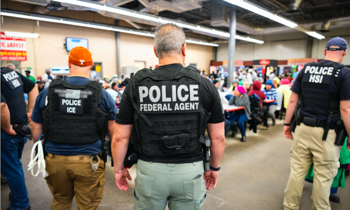 ICE arrests suspected illegal immigrant workers during a worksite enforcement operation at a meat processing plant in Canton, Miss., on Aug. 7, 2019.
