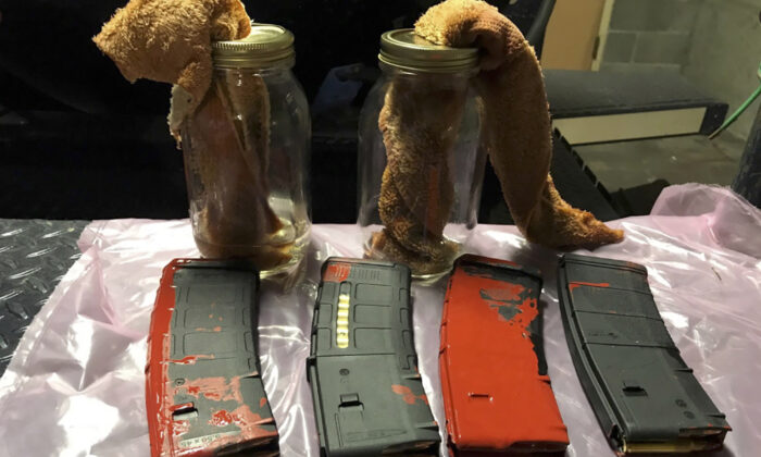 Loaded rifle magazines and Molotov cocktails found at a park in Portland, Ore., on July 26, 2020.