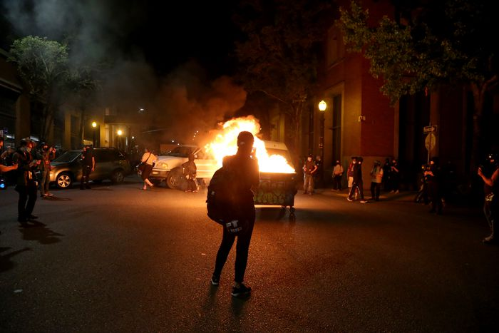 Portland Protesters set a dumpster on fire at the Multnomah Building in SE Portland on Aug. 18, 2020.