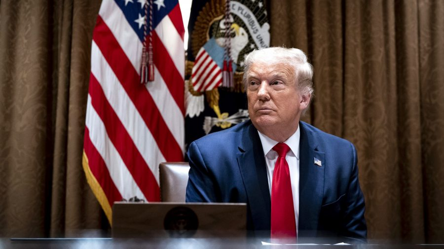 President Donald Trump makes remarks as he meets with tech workers and signs an Executive Order on Hiring Americans, in the Cabinet Room of the White House on August 3, 2020.