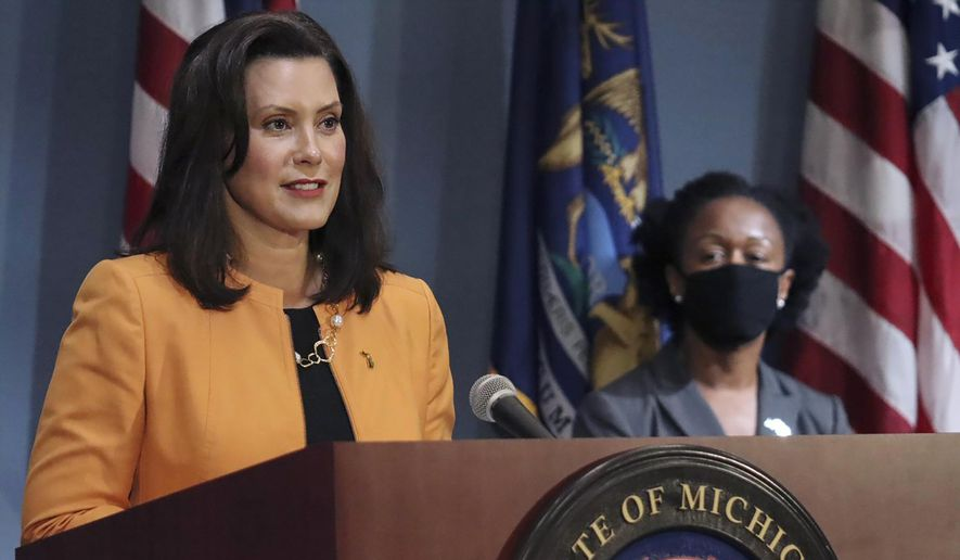 Gov. Gretchen Whitmer addresses the state during a speech in Lansing, Mich.
