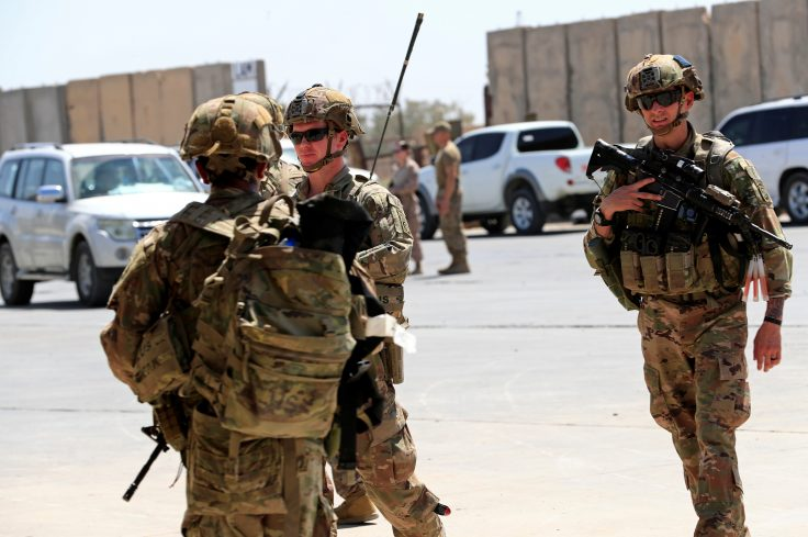 U.S. soldiers are seen during a handover ceremony of Taji military base from US-led coalition troops to Iraqi security forces, in the base north of Baghdad, Iraq