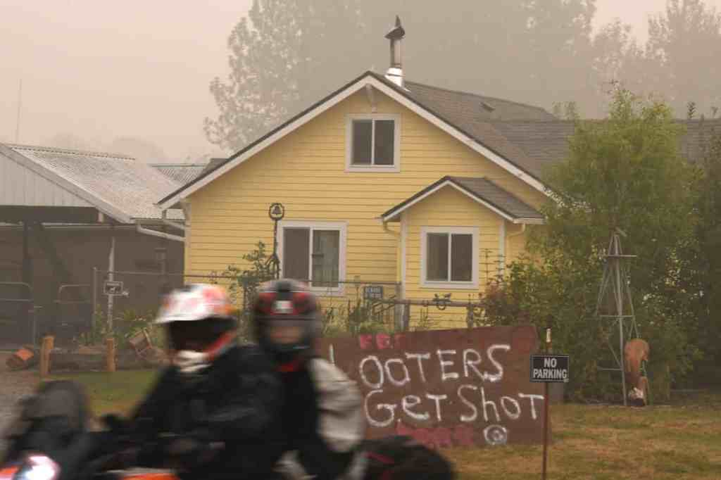 A sign reads 'Looters Get Shot' outside a residence in Molalla, Oregon, on Sunday.
