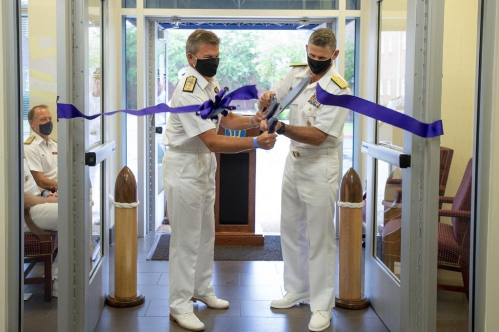 Royal Navy Rear Adm. Andrew Betton, deputy commander of Joint Force Command Norfolk, (left) and U.S. Vice Adm. Andrew Lewis, commander of the command, cut the ribbon during an Initial Operational Capability ceremony on Thursday.