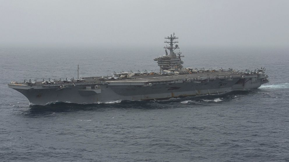 In this photo released by the U.S. Navy, the aircraft carrier USS Nimitz transits the Arabian Sea on Aug. 17, 2020.