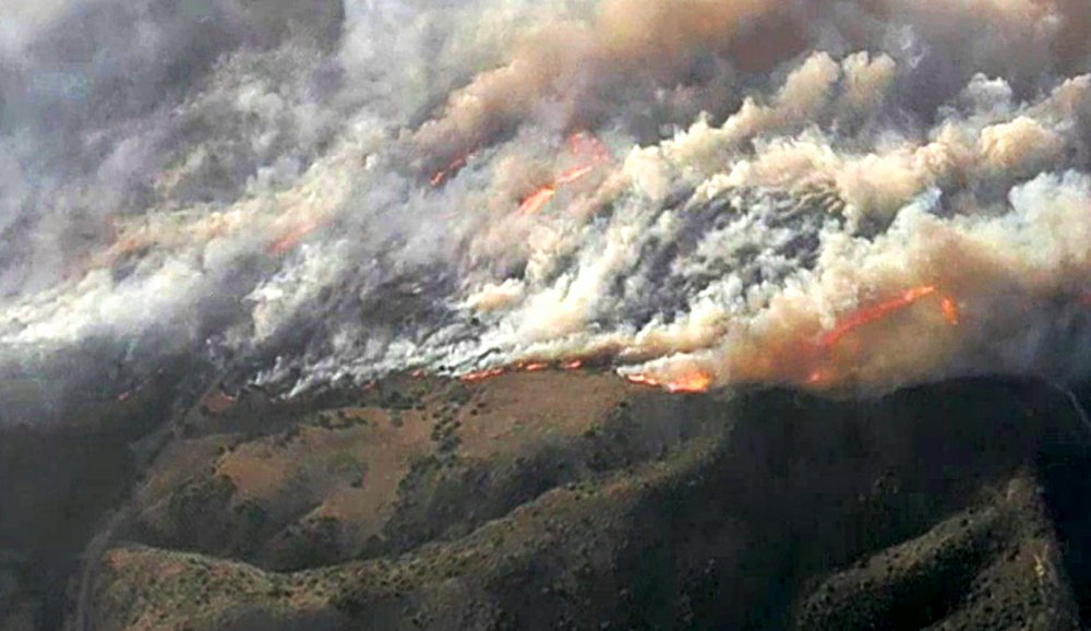 In this image from video provided by KNBC-TV, smoke and flames from the Silverado fire threatens areas near Irvine, Calif., Monday, Oct. 26, 2020.