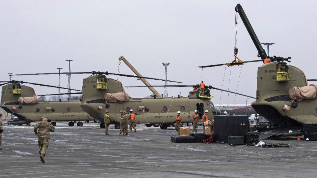 U.S. Technicians prepare helicopters for the transport in Bremerhaven, northern Germany, Sunday Feb. 12, 2017.
