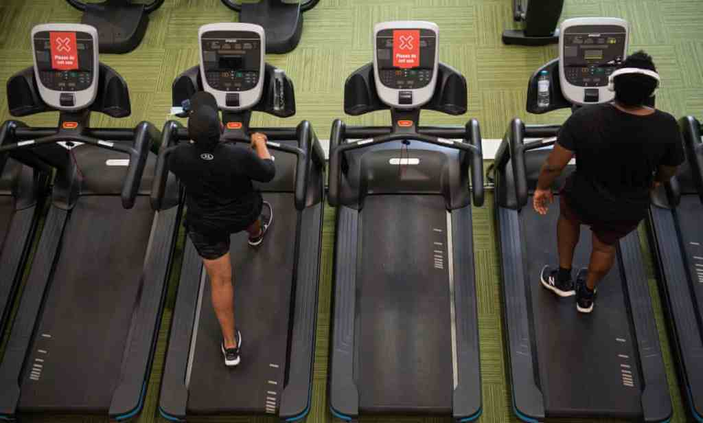 PureGym members exercise between 'do not use' machines at the branch in Leamington Spa, Warwickshire, central England.