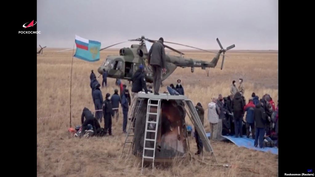 Members of a search-and-rescue team at the landing site of the Soyuz MS-16 space capsule in a remote area outside Zhezkazgan, Kazakhstan, on October 22.